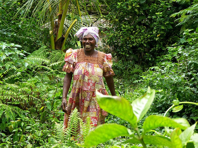 Encountering a local Tannese lady, who is sharing a joke with our tour guide,while walking along one of the many Kastom Trails on Tanna Island.