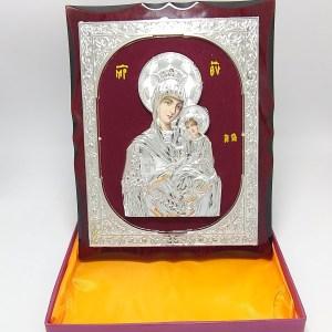 Icoana Portăriţa argintie pe catifea rosie