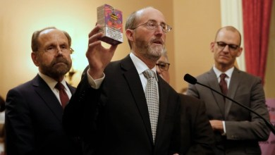 California state Sen. Steve Glazer, D-Orinda, displays a box of flavored e-liquid for vaping as he discusses his support for a measure by state Sen. Jerry Hill, D-San Mateo, left, to ban flavored tobacco products, during a news conference, Wednesday, March 27, 2019, in Sacramento, Calif. If approved by the Legislature and signed by the governor, Hill's measure to ban the sale of flavored tobacco products in stores and vending machines in California,. At right is Assemblyman Kevin McCarty, D-Sacramento. (AP Photo/Rich Pedroncelli)