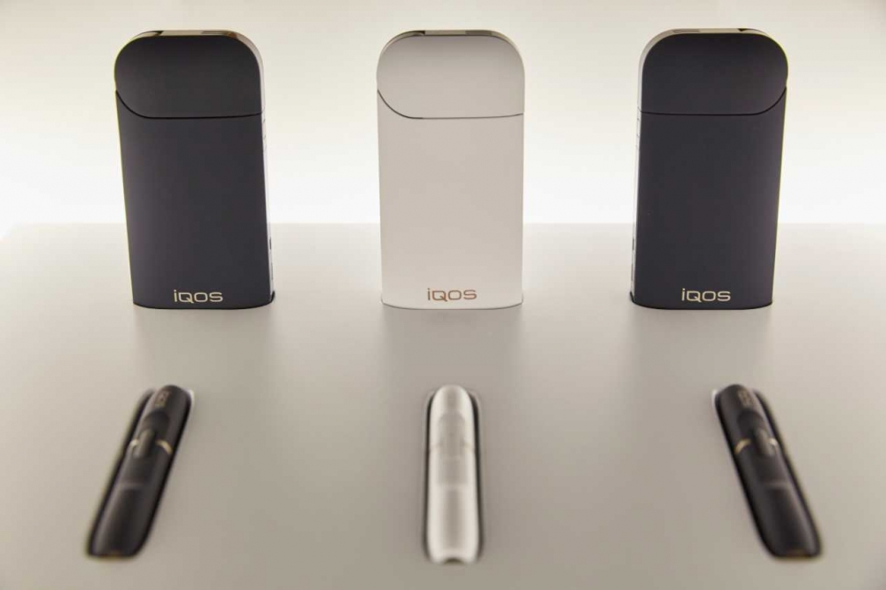 The U.S. Food and Drug Administration has granted permission to market a new IQOS heated tobacco system that exposes the user to fewer chemicals than cigarettes. (Photo courtesy of PMI America)