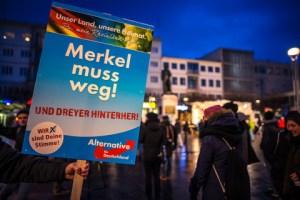 Kosningaspjöldum AfD var beint gegn Angelu Merkel.