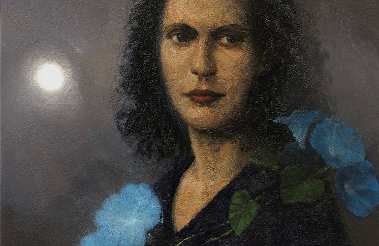 A portrait of painter Leonora Carrington with blue morning glory flowers draped around her shoulders. A bright white orb shines through a grey haze behind Carrington.