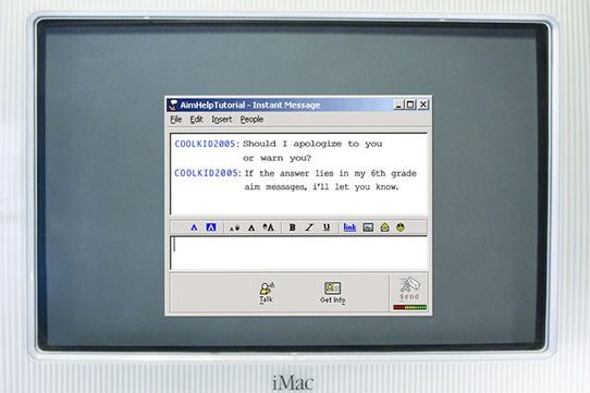 """An AIM Help Tutorial chat dialogue open on the screen of an early 2000s iMac desktop computer. User COOLKID2005 says: """"Should I apologize to you or warn you? If the answer lies in my 6th grade aim messages, I'll let you know."""""""