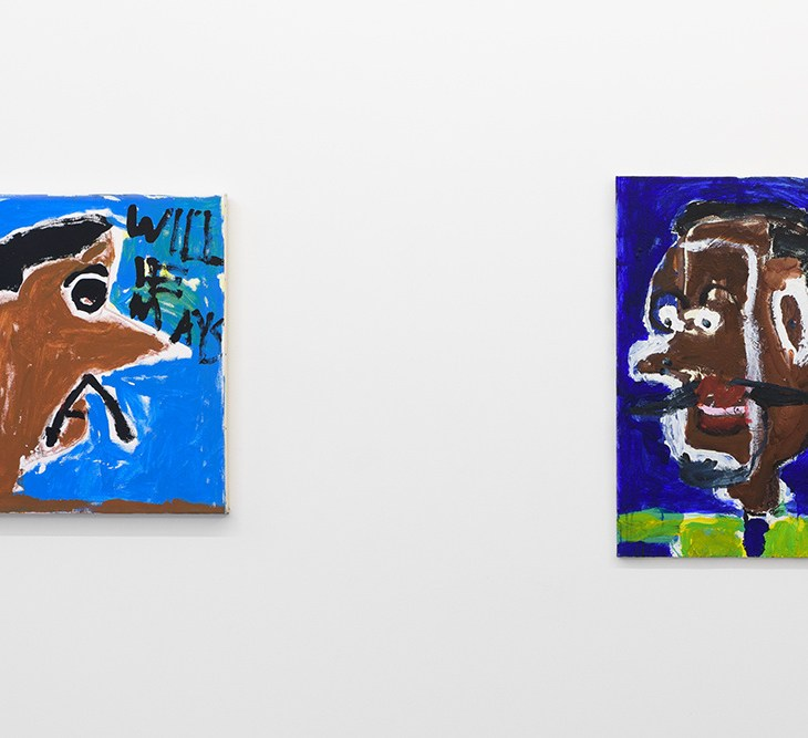 """Two paintings hanging on a white wall. The painting on the left is square and features a side profile portrait of a man with brown skin a, black hair, and a black mustache, looking to the right on a blue background. The words """"Will E Mays"""" hover the man's large nose. The paining on the right is rectangular, and features a man in profile, facing left, with darker brown skin, black hair, and a black mustache on a deep blue background, wearing a lime green shirt."""