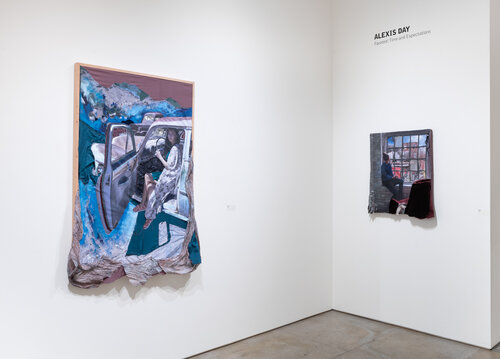 """two fabric tapestries hang on white walls, under the name of the artist, """"Alexis Day,"""" in black. On the left, the larger of the two features a woman seated in a car with the driver-side door open and both her legs outside the door, while blue mountains loom in the background and what seems to be snow spills out of the bottom frame of the painting, as part of the fabric of her tapestry transforms her two-dimensional painting into a three-dimensional piece. On the right, a woman is seated on the windowsill of an industrial-style window, and the fabric of a sofa chair opposite her spills out of the """"frame"""" of the tapestry."""