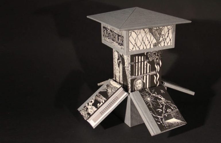 At first glance, a guard tower, onto which is pasted images of a woman sitting beneath prison bars, a bird caught in barbed wire—when you lean in closer, you notice this tower is made up, in part, of books leaned together.