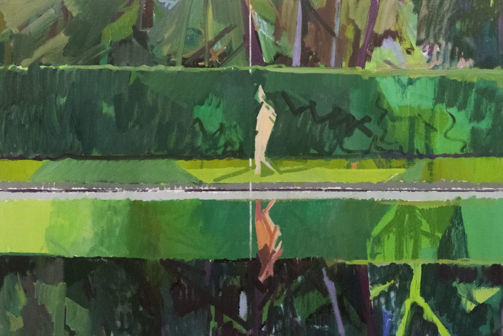 A figure walks along the edge of the water, their reflection, as well as the lush greens and subtle pinks of the well-trimmed foliage behind them, mirrored on the glassy surface without a ripple.