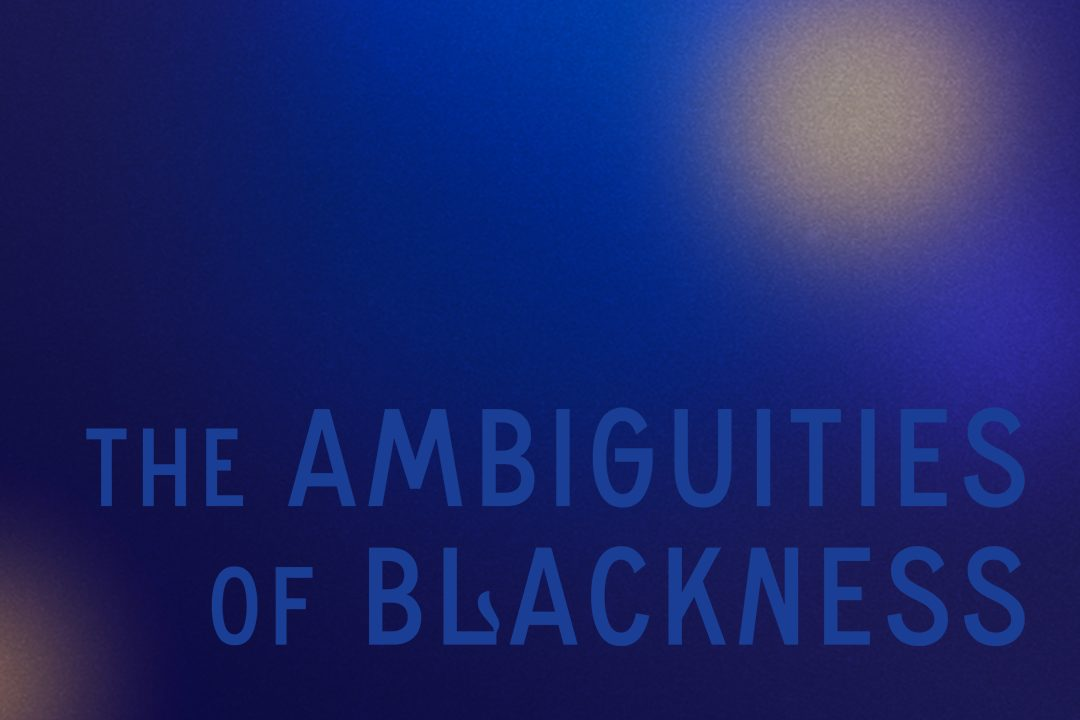 """Against a muffled blue background, the words """"The Ambiguities of Blackness"""" emerge in a lighter shade. Orbs of yellow hover in the distance."""