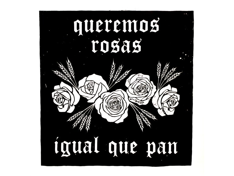 """Black square with roses and wheat buds centered in a bouquet and the words """"queremos rosas"""" printed above and """"iqual que pan"""" below."""""""