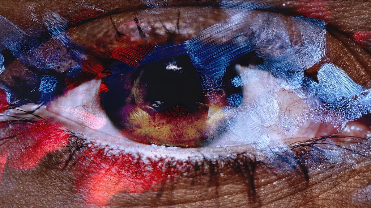 An image, incredibly close, of an eye—the surface of the image smudged and blurred by fingerprints.