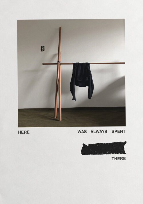 """The word """"here"""" is fixed to the bottom left of a photograph, the words """"was always spent,"""" something marked out, and then """"there"""" are fixed to the bottom right. The photo itself depicts a piece of clothing hanging on a wooden bar."""