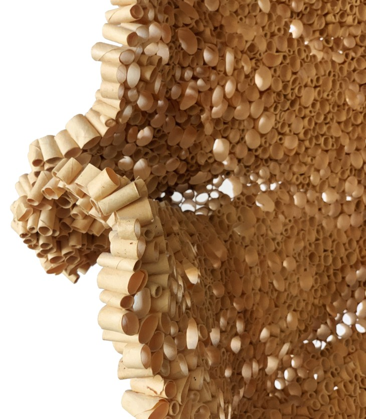 Like the undulating interior of a beehive, this piece combines hundreds of small cylinders of wood to form a porous, contorting wall.