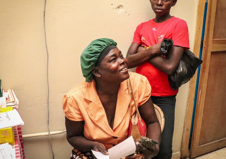 Dr. Manno's patient and her son, at his clinic, Sante 2000, in Haut Limbe, Haiti.