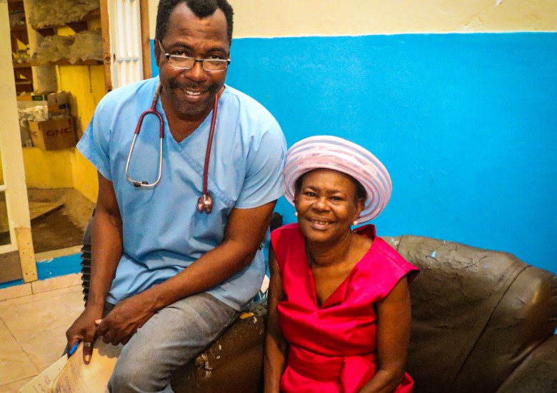 Dr. Manno and his patient at his clinic Sante 2000 in Haut Limbe, Haiti.