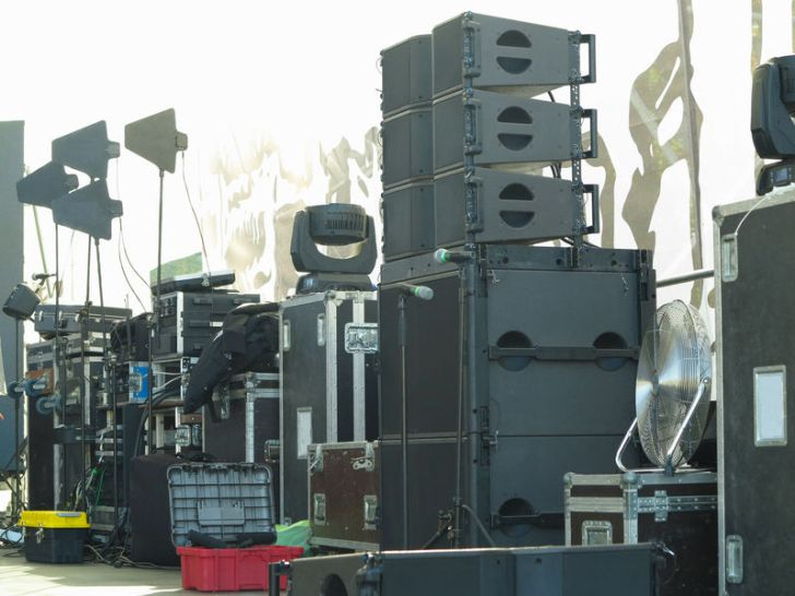 Concert stage equipment, speakers, amplifiers, lights,boxes and musical instruments.