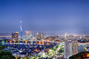 Fukuoka city, Japan, at twilight with bridge, lights and traffic motion.