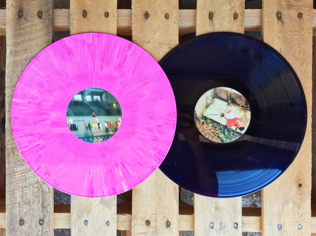 photograph of floral print mirror stages records tiny engines