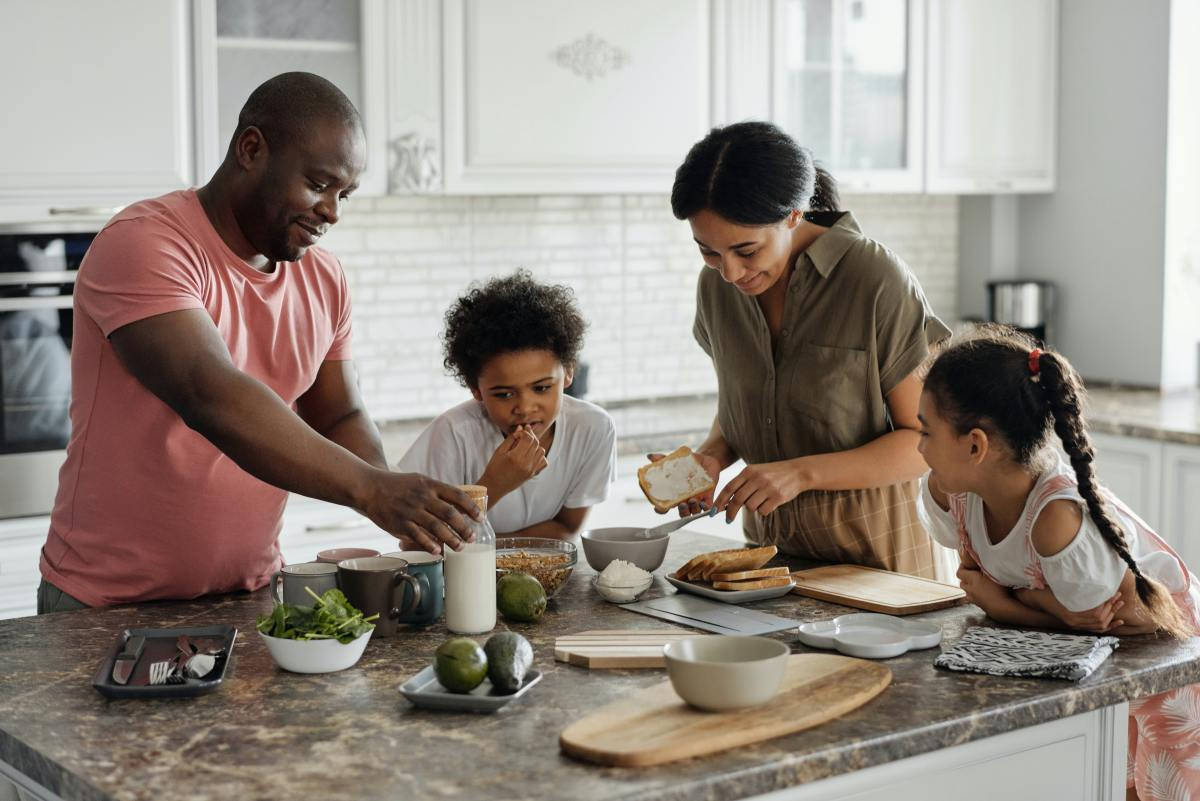 family-making-breakfast-in-the-kitchen-4259140