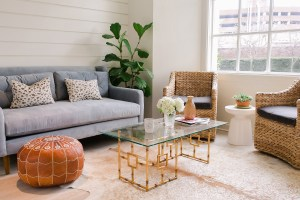 varnishlane couch and chair next to a window and coffee table inside the boutique edit - varnishlane-couch-and-chair-next-to-a-window-and-coffee-table-inside-the-boutique-edit
