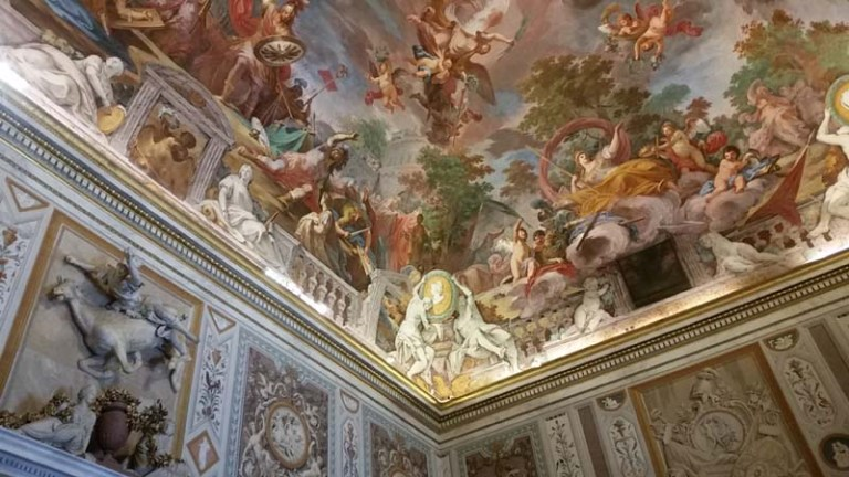 A mural on the ceiling in the Galleria Borghese depicting flying horses, angels and humans