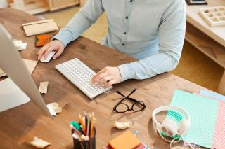 Web designer using computer