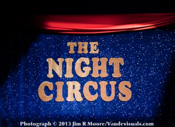 The Night Circus Banner hangs across the curtain during the show.