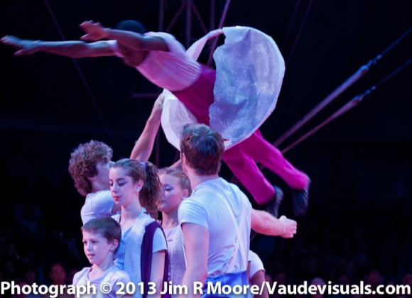 St. Louis Arches member jumps thru a hoop during one of their feats of amazement.