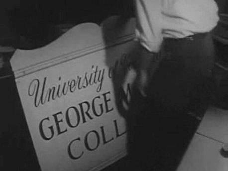 """Preparing to move """"George Mason College"""" sign."""