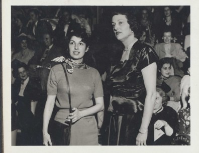 Zelda Fichandler and another woman standing in front of an audience in the Hippodrome, probably in 1950. Arena Stage records, #C0017, Box 633, Folder 1, Special Collections Research Center, George Mason University Libraries.