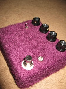 A trip further down the faux-fur covered rabbit-hole, this time featuring a modified Number 23. Other than re-defining how literal one can interpret the word fuzz, this box nixes the voltage sag that was included in the first batch of 23's and instead replaces it with an additional boost to assist with those moments when loud just isn't enough. Similar to 23 Mk I, I also decided to experiment with different combinations of clipping diodes, eventually settling on a combination of a silicon diode and a pink LED. The resulting sound ends up being much harsher and metallic than it's predecessors, but in all, I think that's a good thing.