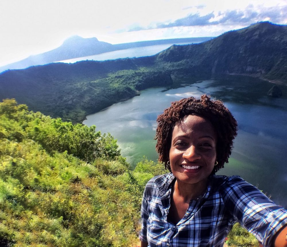 Black travel blogger at Taal Crater Lake, Philippines http://vaycarious.com