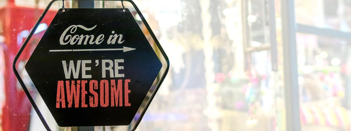 Image of a sign that says Come In We're Awesome