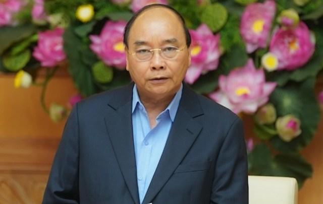 Thủ tướng Nguyễn Xuân Phúc chủ trì cuộc họp bàn giải pháp đón sóng đầu tư sau Covid-19. Ảnh: VGP