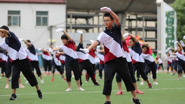 Học sinh Trung Quốc trong một giờ học Thể dục. Ảnh: CGTN.
