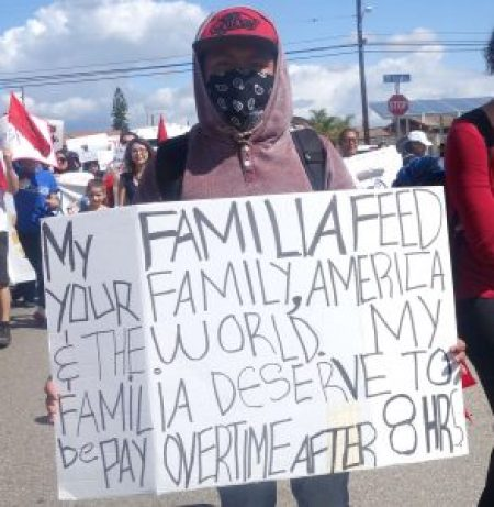 A protester at Oxnard's Annual Cesar Chavez Memorial March on Sunday, April 10.