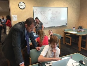 County Supervisors demonstrate coding to students at the Maricopa County Library District in Arizona, where Antonio Apodaca was once a librarian.