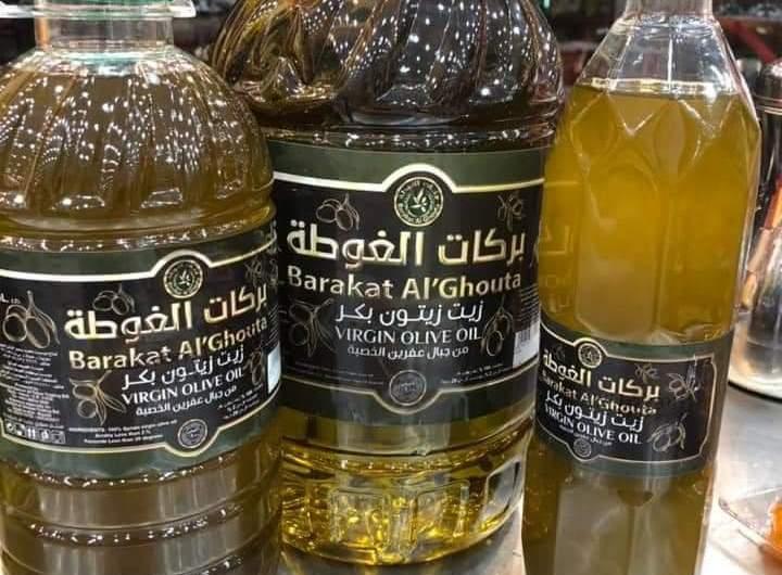 """زيت زيتون مدينة عفرين بدأ تصديره برعاية تركية وبيعه في الأسواق تحت اسم """"بركات الغوطة"""""""