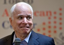U.S. Sen. John McCain, R-Ariz., reacts as a lightning hit a nearby building while answering to questions from students of the Japan-America Student Conference (JASC) at the Tokyo American Center in Tokyo, Japan, Wednesday, Aug. 21, 2013. McCain on Wednesday called on US officials to use their influence over Egypt, as members of Congress remain spilt over whether to cut off military aid to the country. (AP Photo/Franck Robichon, Pool)