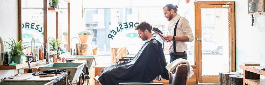 Man And Barber Chatting In Barber Shop