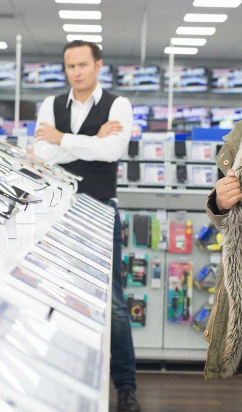 Store Clerk Catching Shoplifter