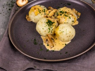 Vegan potato dumplings with majoram and  creamy mushroom gravy