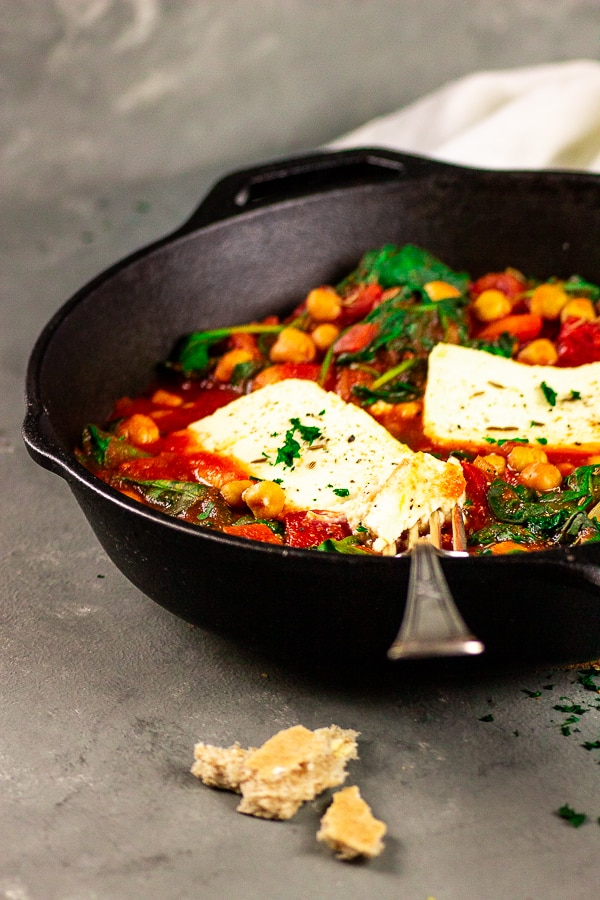 Vegan Feta Chickpea Skillet with Spinach - A fast and delicious dinner which is whipped up in minutes. Prepare this one-pot skillet on weekdays and serve it with delicious Naan bread. Vegan | Vegetarian | Gluten-free | Dairy-free | Lactose-free | plant-based