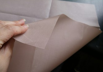 It's flexible not unlike waxed fabric, and is easy to cut