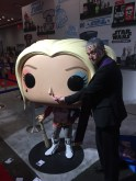 Father Delaney checks Pop! Harley Quinn's nose for demons