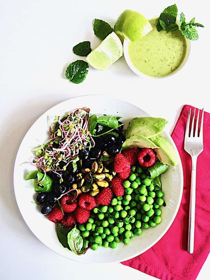 Berry, Pea & Pistachio Summer Salad + Sugar Free Mojito Dressing Recipe - Enjoy fresh seasonal produce with this colorful salad showcasing fresh raspberries, blueberries, peas and toasted pistachios over crisp greens, topped with an easy, zesty sugar free lime + mint mojito vinaigrette dressing! | Vegan, Gluten Free, Paleo | veganchickpea.com