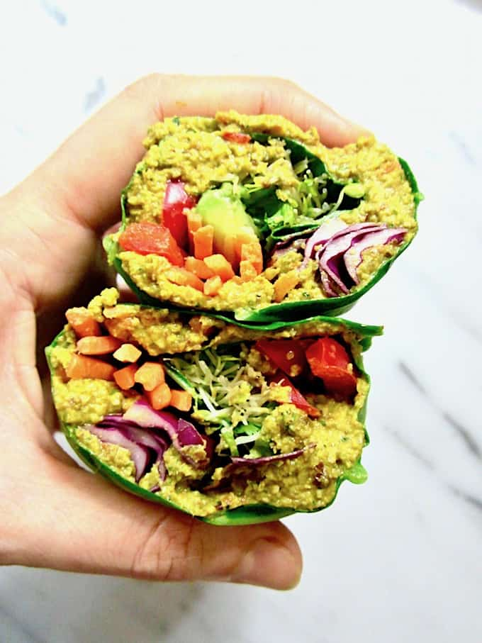 This Raw Rainbow Collard Green Wraps with Curry Sunflower Seeds recipe is a super healthy, crunchy lunch you can make ahead that will leave you feeling fresh & energized. It's customizable with whatever veggies you want, low carb and friendly for all diets! {vegan, gluten free, paleo, whole 30, sugar free, soy free} | veganchickpea.com