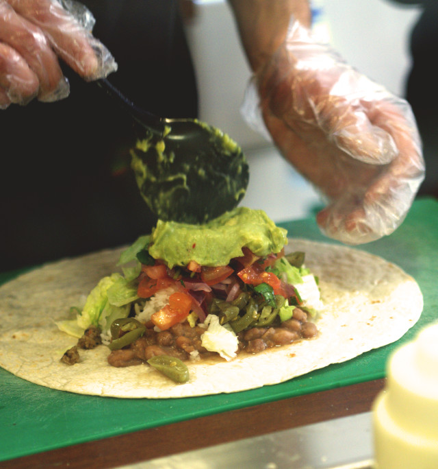 Making up the burrito at Taco Mazama, Edinburgh