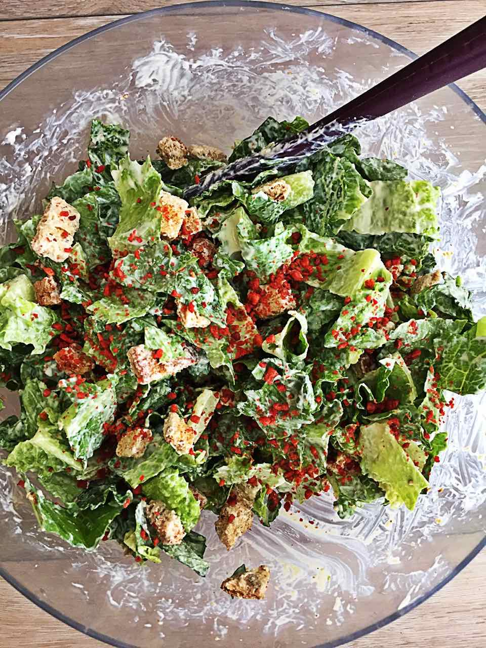 Image of Vegan Caesar Salad with Imitation Bacon Bits in a large salad bowl.
