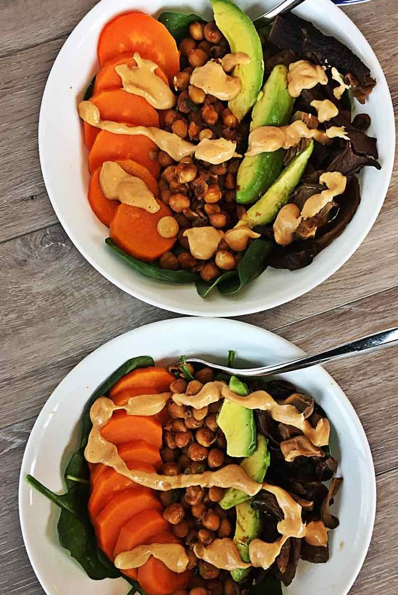Image of two fiery chipotle maple sweet potato tofu chickpea mushrooms vegan healthy bowls.
