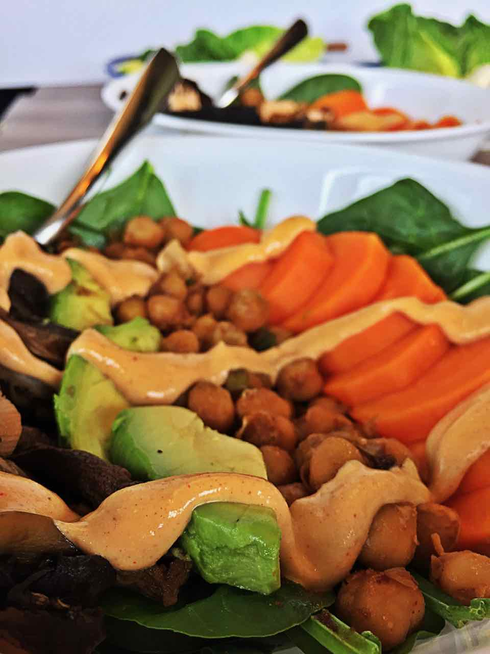 Image of fiery vegan sweet potato chickpea mushroom spinach bowl.